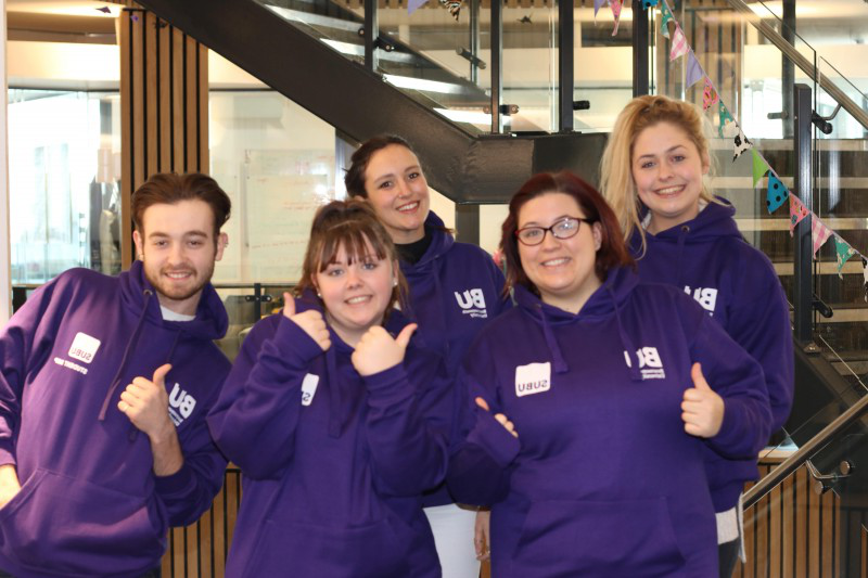 Group iof SUBU Student Reps in purple hoodies
